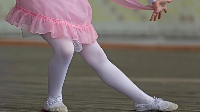 Young girl tries to perform ballet positions (Deseret Photo)