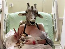 UPDATE: Giraffe lady gives birth to baby boy