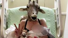 UPDATE: Giraffe lady gives birth to baby boy