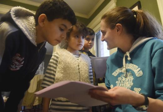 In this Wednesday, Jan. 18, 2017, Chelsea Krieger with the United Congregation Church works with Al Kalaf children Mohammad, 12, foreground, Rasha 6, and Abdul, 8, on their homework at their home in Manchester, Conn. (Deseret Photo)