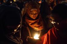 "Muna Endris, left, Yousra Abdulrazig, center, and Hanan Endris, right, hold candles as people gather for Inextinguishable: Light the way for refugees and immigrants, a multi-faith candlelit vigil, on Tuesday, Jan. 31, 2017 at Turner Park in Omaha, Neb. The vigil was organized in support of refugees. Abdulrazig said she came to ""give a voice to people who don't have the opportunity to come to America"" The vigil was organized in support of refugees and immigrants. (Deseret Photo)"