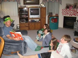 """Sam-I-Am reads """"Green Eggs and Ham,"""" by Dr. Seuss, to his children, Kayla, Layna, Hanna and Aaron on St. Patrick's Day. (Deseret Photo)"""