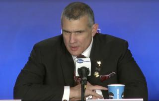 Coach Frank Martin addresses a young reporter's question at a press conference. (Deseret Photo)