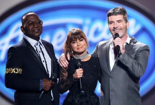 "FILE - In this April 7, 2016 file photo, former judges Randy Jackson, from left, Paula Abdul, and Simon Cowell appear at the ""American Idol"" farewell season finale in Los Angeles.  The show is receiving the TV academy's 2016 Governors Award for its impact on television.