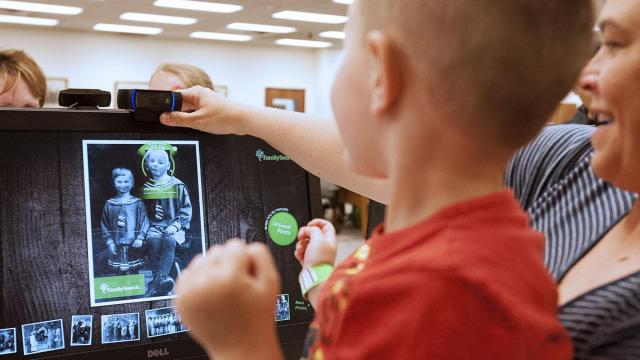 Karlie Lundell helps her son Jesse Lundell take a picture at the Family History Library in Salt Lake City, Saturday, June  11, 2016. (Deseret Photo)