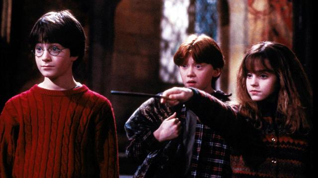 "Left to right, Harry Potter (Daniel Radcliffe), Ron Weasley (Rupert Grint) and Hermione Grainger (Emma Watson) in ""Harry Potter and the Sorcerer's Stone."" Photo by Peter Mountain (Deseret Photo)"