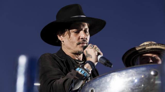 Actor Johnny Depp addresses film goers at the Glastonbury music festival at Worthy Farm, in Somerset, England, Thursday, June 22, 2017. (Photo by Grant Pollard/Invision/AP) (Deseret Photo)