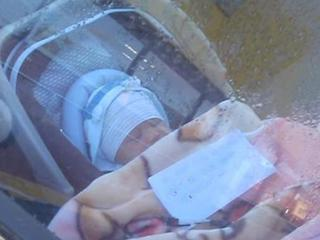 Baby locked in a car with a note outrages people passing by