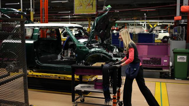 Workers are shown on the assembly line at the BMW Mini Plant Oxford on Nov. 18, 2013. (Deseret Photo)