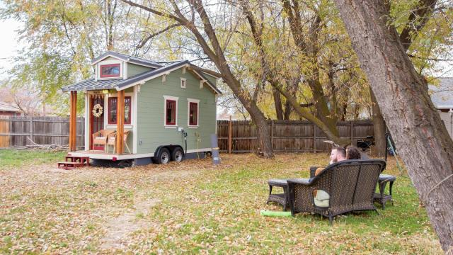 Meg and Dan Stephens relax on a bench outside their tiny house. (Deseret Photo)