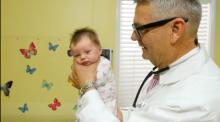 IMAGE: Crying baby? You'll be singing this pediatrician praises for the simple hold he's about to teach you