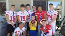 IMAGE: This Football Team Showed Up For A Boy's Birthday Party After Learning He Only Got 1 RSVP From His Classmates