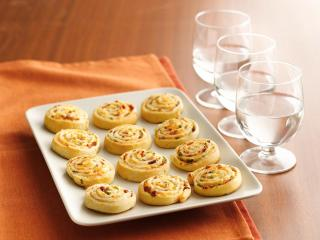 Save time and please the crowd with the simple addition of appetizers like Bacon-Cheddar Pinwheels to your menu this year.