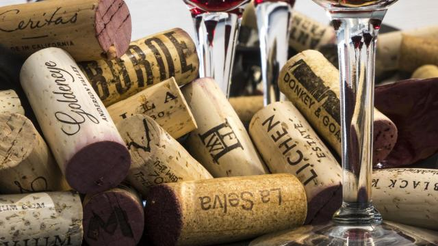 Corks rest beneath wine glasses during a panel tasting of Anderson Valley pinot noir in New York, July 23, 2018. Top producers have swarmed to the region in Mendocino to make restrained, nuanced wines. (Tony Cenicola/The New York Times)