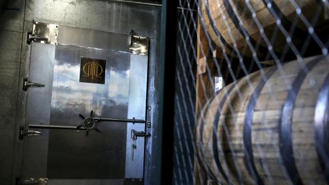 A vault-like metal door seals the room where Buffalo Trace stores barrels it doesn't plan to bottle for decades at the company's distillery in Frankfort, Ky., Oct. 23, 2018. The American whiskey usually peaks much earlier than long-aging liquors like Scotch. But Buffalo Trace hopes its new climate-controlled warehouse in Kentucky can change that. (Aaron Borton/The New York Times)