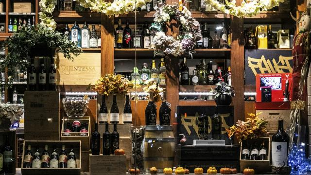 A Thanksgiving theme window display at K&B Wine in New York, Nov. 7, 2018. Serve red and white wines at Thanksgiving, and budget at least one bottle per drinker. (Jeenah Moon/The New York Times)..
