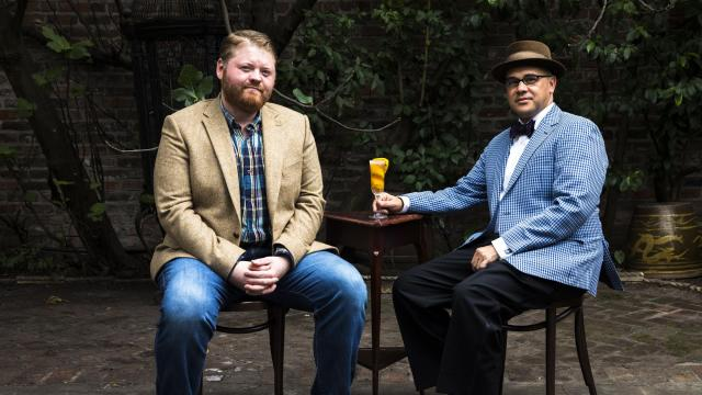 Nick Detrich, left, and Chris Hannah in the courtyard of their new bar, Jewel of the South, with the brandy crusta cocktail that helped make the original Jewel famous, in New Orleans, Oct. 20, 2018. The two bartenders plan to open the bar in homage to Joseph Santini and his brandy crusta. (Sara Essex Bradley/The New York Times)