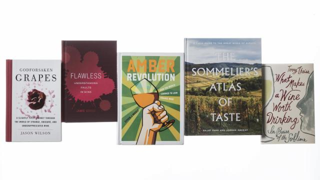 Books about wine, in New York, Nov. 14, 2018. These five new volumes investigate some of the most basic issues raised by wine, while posing new questions and inspiring thirst. (Tony Cenicola/The New York Times)