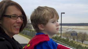 Cindy Stevens and grandson Wyatt, age 2, watch a plane take off at RDU's Observation Park.