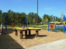 Wake Forest unveils new equipment for kids with disabilities at Kiwanis Park.