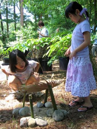 Sarah and Catherine Kunz build a fairy house at 2009 Family Fun Day. Photo by Orla Swift of Duke Gardens.