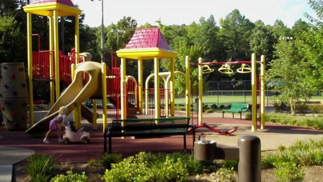 The playground at Ritter Park in Cary has a rubber mat surface.