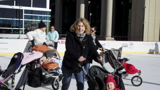 Sarah Lindenfeld Hall skating during stroller skating at downton Raleigh's Winterfest.