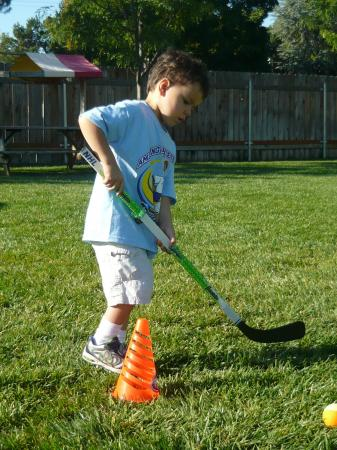 Kids learn sports such as hockey during the program.