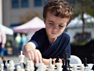 Grady Dalton, of Raleigh, concentrates on the chess move at hand.