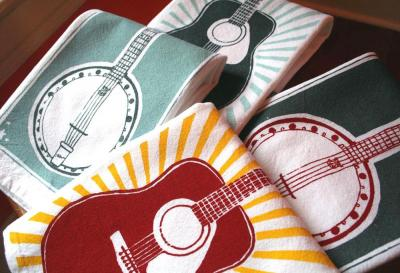 Raleigh mom Kelly Smith-Tilly screen prints tea towels, kids T-shirts and scarves.