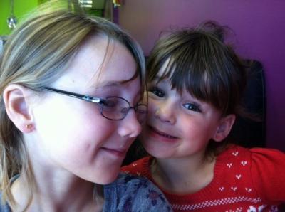 Lynda Loveland's daughters get their ears pierced.