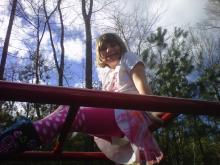 Amanda's daughter atop the monkey bars