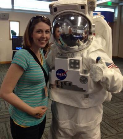 Kathy Hanrahan and a NASA astronaut at the Nature Research Center grand opening in mid-April.