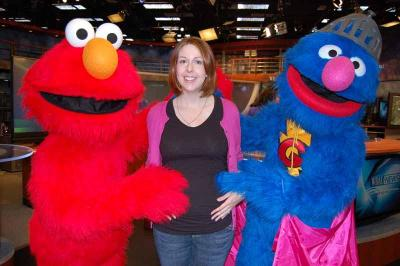 Kathy at 6 ½ months pregnant, after interviewing Elmo and Super Grover for an Out & About story.