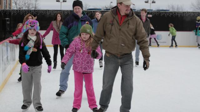 A dad and his daughter skate around Sunday afternoon at City Plaza in downtown Raleigh. (Photo by Wes Hight)