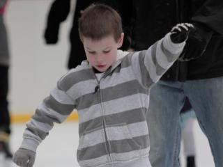 He has the hang of ice skating now and is having fun Sunday afternoon at City Plaza in downtown Raleigh. (Photo by Wes Hight)