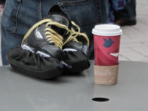 Many people had their ice skates ready with a cup of hot chocolate to try and stay warm Sunday afternoon at City Plaza in downtown Raleigh. (Photo by Wes Hight)