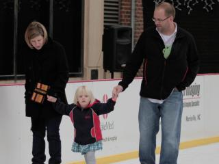 This family skates together Sunday afternoon at City Plaza in downtown Raleigh. (Photo by Wes Hight)