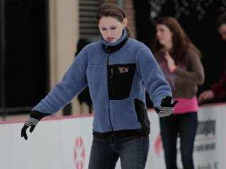 Many people concentrate and try and keep their balance  Sunday afternoon while ice skating in the cold at City Plaza in downtown Raleigh. (Photo by Wes Hight)