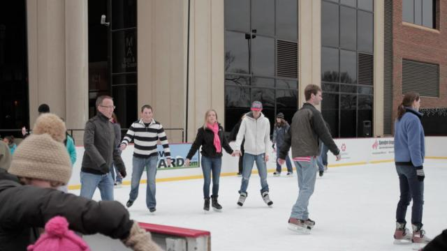 Many people have fun Sunday afternoon sledding and ice skating in the cold at City Plaza in downtown Raleigh. (Photo by Wes Hight)