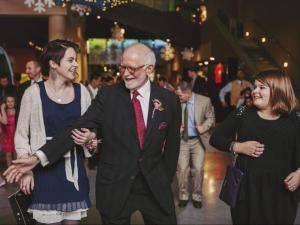 Bobby collins grooves with his daugthers Julia and Abigail at the Triangle Father-Daughter dance.