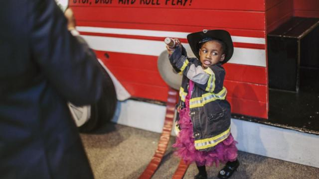 "Kennedi Washington, 3, of Raleigh, plays with a firehouse at the Marbles museum for the Triangle Father-Daugther dance. Her father, Kemah, said she's been ""waking up every morning asking about the party."""