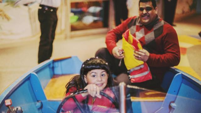 Dianna Roa, 5, of Raleigh, and her dad, Julio, play in a boat in the Marbles museum in downtown Raleigh.