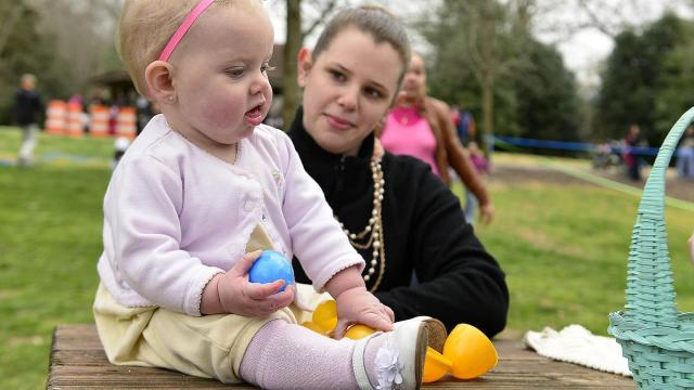 Kelly Sharon of Raliegh sits with her nine-month-old daughter Chelsea during the Pullen Park Egg Hunt Saturday, Mar. 23, 2013.  The annual event is held for children ages 10 and under with the eggs containing healthy snacks and other prizes.  (Photo by Jeffrey A. Camarati)