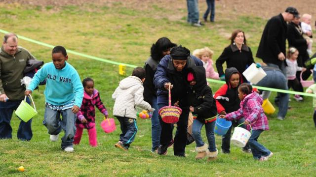 Parents and children scramble across the grass looking for eggs during the Pullen Park Egg Hunt Saturday, Mar. 23, 2013.  The annual event is held for children ages 10 and under with the eggs containing healthy snacks and other prizes.  (Photo by Jeffrey A. Camarati)