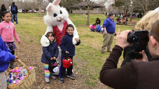Kids have their photo taken with the Easter Bunny following the Pullen Park Egg Hunt Saturday, Mar. 23, 2013.  The annual event is held for children ages 10 and under with the eggs containing healthy snacks and other prizes.  (Photo by Jeffrey A. Camarati)