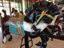The historic Chavis Park carousel, built around 1916, reopens to the public on Saturday, April 20, after a massive project that moved it into its own carousel house.