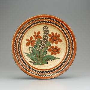 Dish, probably made during Gottfried Aust's tenure as master of the pottery at Salem, North Carolina, 1775-1785. Lead-glazed earthenware. Image by Gavin Ashworth, courtesy of Old Salem Museums & Gardens.