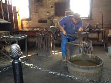 Blacksmith at work at Antler Hill Village, Biltmore estate