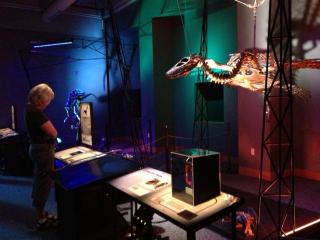 Dinosaurs in Motion at the N.C. Museum of Natural Sciences features 14 life size metal dinosaur sculptures that visitors can move using lever and pulleys or remote controls.